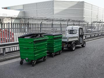 Towing of waste collection bins