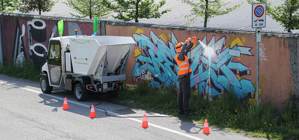 Waste collector vehicle with pressure washer - The silent electric motor vehicle for cleaning of urban areas
