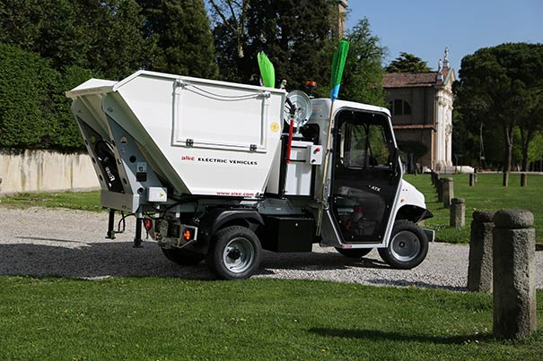 Alke' electric utility vehicle with pressure washer and waste collection body