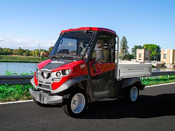 Electric utility vehicles with loading bed