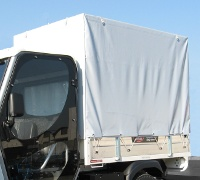 Tarpaulin covered loading bed with optional drop panels on all 3 sides.