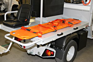 Electric ambulance with spinal board