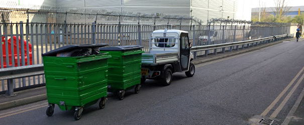 Electric vehicles for towing waste bins